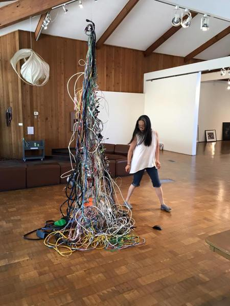 Chenhung Chen installing her work for the ALL MEDIA 2016 - Exhibition,  Irvine Fine Arts Center