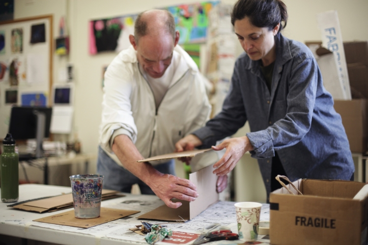 """Pulling The Forest Along The Road"" Darren Petersen and Diana Markessinis Working at Hope Center For The Arts Photo Credit Eric Stoner"