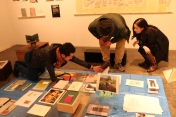"""Transit Republic. Kenichiro Egami explaining the archive in his project room """"emerging from the rubble - Art/Activism against the gentrification in East Asia"""" Photo Courtesy of Kio Griffith."""