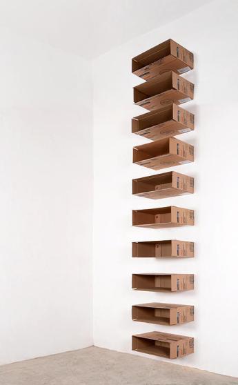 Los Angeles Nomadic Division (LAND) Jose Davila. Jose Davila, Untitled, 2015, cardboard boxes and bottle caps, 168.5 x 24 x 18.9 inches. Courtesy of Jose Davila.