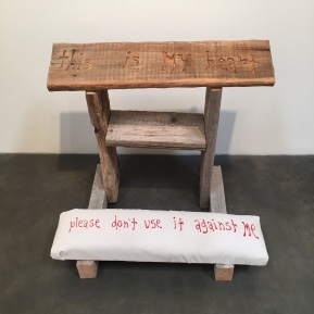 "Prayer Kneeler, 2016 carved wood from fallen down windmill, cloth 29 x 33 x 24"". Michael Deyermond: This is my heart, please don't use it against me. Craig Krull Gallery. Photo Courtesy of Craig Krull Gallery."