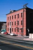 1978, Historic Woman's Building, 1727 N. Spring St with Kate Millett _Naked Lady' sculpture on top. Animating the Archives: The Woman's Building. Avenue 50 Studios, Highland Park. Photo Courtesy of the Artist.