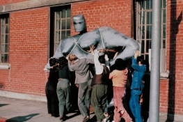 1978, Historic Woman's Building, Kate Millet sculpture, Naked Lady being installed atop the Woman's Building. Animating the Archives: The Woman's Building. Avenue 50 Studios, Highland Park. Photo Courtesy of the Artist.