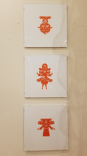 Ouizi Sha. From top to bottom: Come, Sprining, Lucky. Paper Cut-Out. Parallels: Medicine = Art. Crafton Hills College Art: Eyes on Healing. Crafton Hills College Art Gallery. Photo Credit Jacqueline Bell Johnson.
