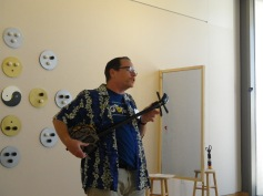 Dr. Gary Williams playing traditional Okinawa string instrument called Sanshin