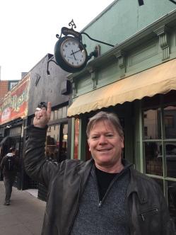Eric Joyner: Tarsus Bondon Dot. Eric Joyner under the clock from the Raven and the Clock Painting. Photo Courtesy of Cory Helford Gallery.