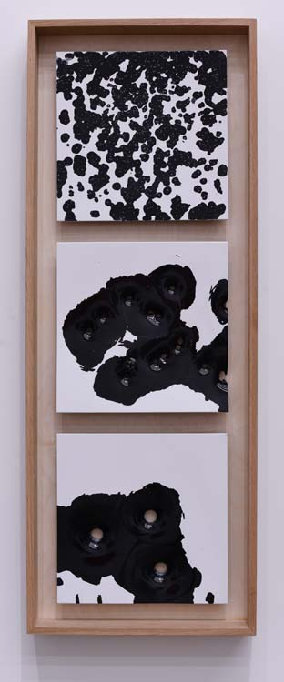 Caliber Abstractions. Nicolas Hunt. Photo Courtesy of Mugello Gallery. Bird, Buck, Slug: White on Black #1 2017 43 inches x 16 inches oil based enamel on anodized aluminum and white oak.
