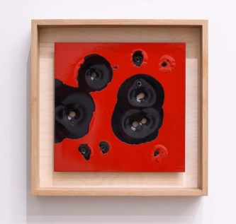Caliber Abstractions. Nicolas Hunt. Photo Courtesy of Mugello Gallery. 45 and AK47 Red on Black Ballistic 2017 16 inches x 16 inches oil based enamel on anodized aluminum and white oak.