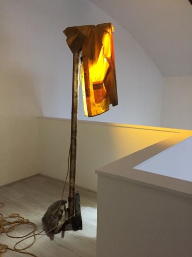 Sun Valley Shroud. Iron, raincoat, LED lamp, stones, cement, cord, string. 2017. Ohlsson/Dit-Cilinn: HYDROGENESIS. HILDE L.A., Mid-City. Photo Credit Shana Nys Dambrot.