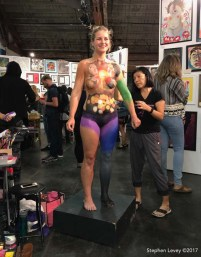 Artist Miho Hiramatsu, model Cameron Hough assistant Melanie Garavito - tribute for Charlottesville tragedy. Chocolate And Art Show Los Angeles - August 18 - 19. Photo credit Stephen Levey