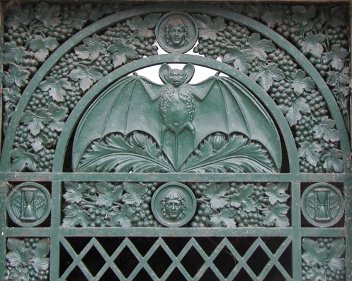 Bat motif on tomb door. Photo © Carolyn Campbell.