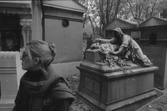 "Photo of Carolyn Campbell by Joe Cornish, 1982 in Père Lachaise Cemetery, Paris – tomb is ""The Last Good-bye"", 1988. Adieu Mere inscribed on tomb.. Sculptor: Léopold Morice. A model of the sculpture was shown at the Salon of 1877."