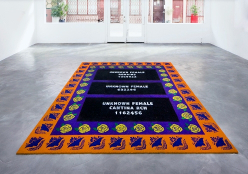Nery Gabriel Lemus. A Memorial to Three Unknown Females, 2016, Acrylic on 15 coconut coir and latex floor mats, 96 X 115 inches