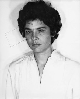 Radical Women: Latin American Art, 1960-1985, Hammer Museum, Los Angeles. Liliana Porter (Argentine, b. 1941), Untitled (Self-portrait with square), 1973. Gelatin silver print made from the original negative. Image: 16 1/4 × 11 in. (41.3 × 27.9 cm); sheet: 20 × 16 in. (50.8 × 40.6 cm). Courtesy of the artist. ©the artist.