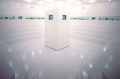 Adrian Piper. What It's Like, What It Is #3. 1991. Video installation. Video (color, sound), constructed wood environment, four monitors, mirrors, and lighting, dimensions variable. Installation view in Dislocations, The Museum of Modern Art, New York, October 20, 1991–January 7, 1992. The Museum of Modern Art, New York. Acquired in part through the generosity of Lonti Ebers, Marie-Josée and Henry Kravis, Candace King Weir, and Lévy Gorvy Gallery, and with support from The Modern Women's Fund. © Adrian Piper Research Archive Foundation Berlin