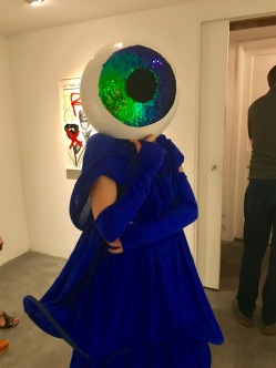 Anaeis Ohanian (artist of costume) at Gabriella Sanchez, By Any Other Name, at Charlie James Gallery. Photo credit: Genie Davis.