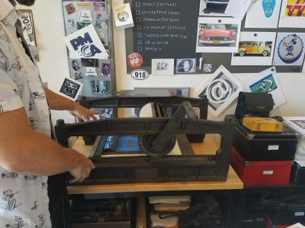 In the studio - printing press. Photo Credit Jenny Begun.