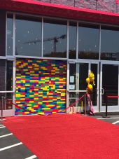 Two-Bit Circus, Micro Amusement Park Grand Opening giant lego wall ribbon cutting. Photo by Sarah Collins.