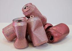 Metal flake on found cans in Sadie Barnette: Black Sky at Charlie James Gallery. Photo courtesy of the gallery.