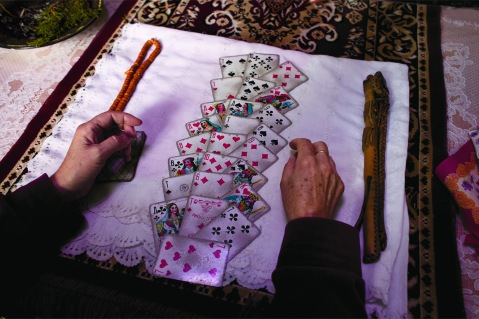 Carolyn Drake, To guide their decision-making, the Kyrgyz often seek out shamans to read their fortune with cards. Women of Vision, Forest Lawn. Photo courtesy National Geographic Society.