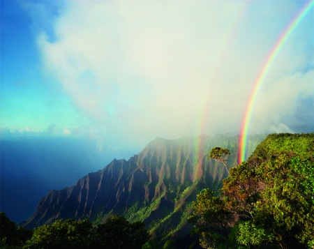 Diane Cooke and Len jenshel, A double rainbow arcs above the jagged cliffs and dense vegetation of Kalalau, the largest valley on Na Pali. Women of Vision, Forest Lawn. Photo courtesy National Geographic Society.