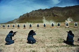 Lynsey Addario, Women—mostly widows—train for police force jobs at a firing range near Kabul. Women of Vision, Forest Lawn. Photo courtesy National Geographic Society.