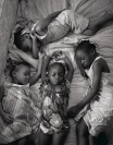 Sleep, MM 7427, Photos by Maggie Steber, Mia Dennis' daughters, ages 3 to 8, look at their new baby brother, Brandon, 10 days old, as he sleeps in his crib. Later the girls have to take their nap on Sunday afternoon. Women of Vision, Forest Lawn. Photo courtesy National Geographic Society.