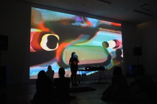 Musician Callie performing with Alex Pelly (Pellyvision) visuals for Dublab, 2016, Femmebit 2019; Image courtesy of Janna Avner